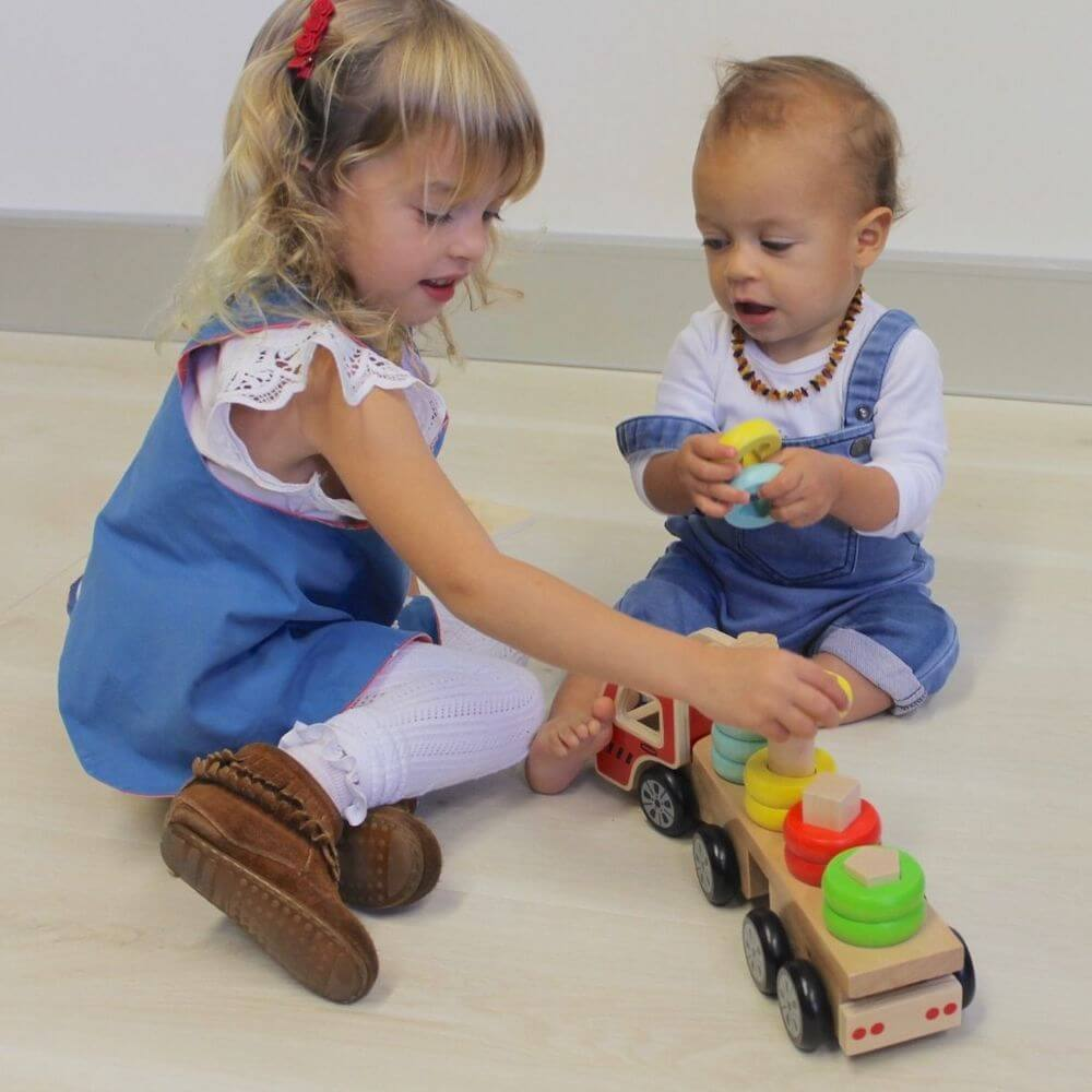 kids playing with stacking truck